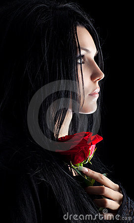 Brunette goth woman with rose portrait