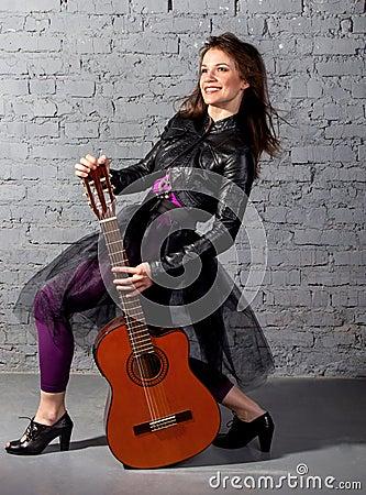 Brunette guitar player woman