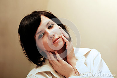 Brunette with hands on face