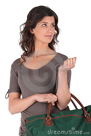 Brunette holding luggage