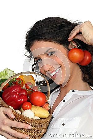 Brunette holding vegetables