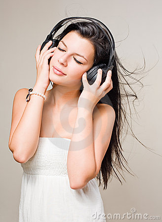 Brunette immersed in music wearing headphones.