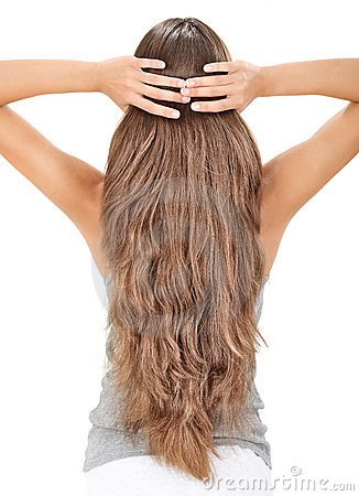 Brunette lady holding long hairs, view from back