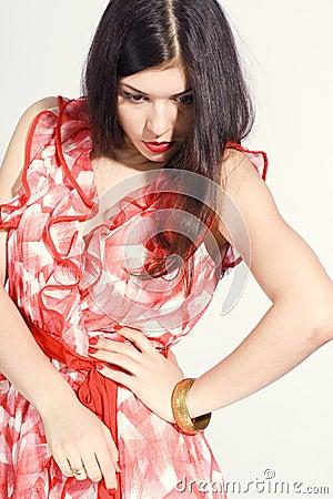 Brunette lady in red dress