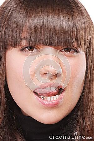 Brunette licking lips