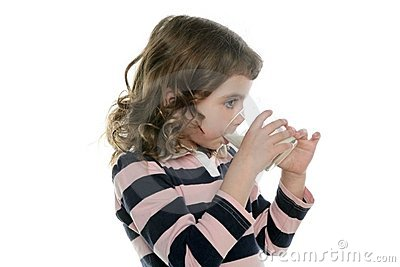 Brunette little girl drinking glass of milk