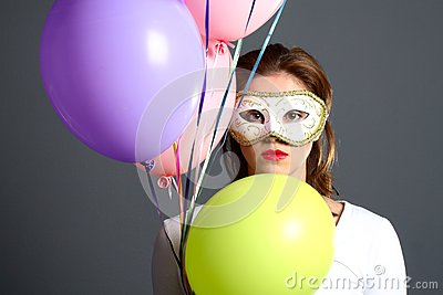 Brunette with mask and balloons