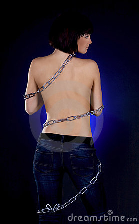 Brunette with nude back in chains