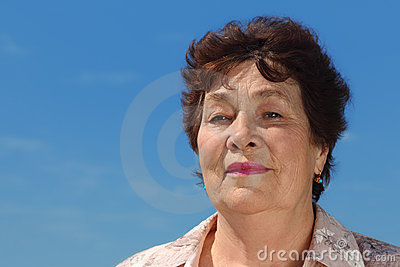 Brunette pensioner woman outdoor