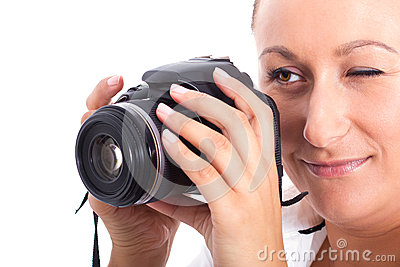 Brunette photographer woman holding camera