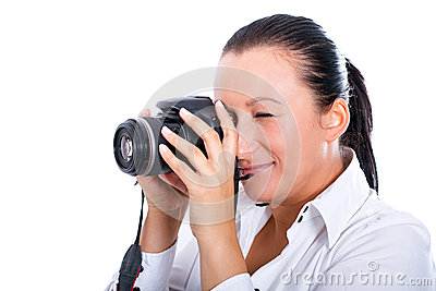Brunette photographer woman making photos on DSLR