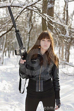 Brunette with the raised rifle