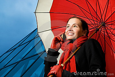 Brunette with red umbrella