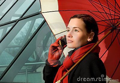 Brunette with red umbrella