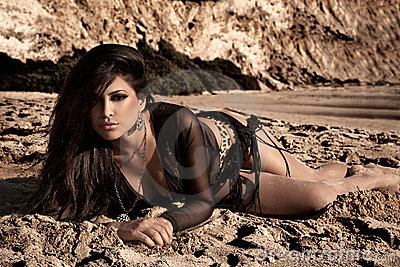 Brunette In The Sand