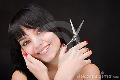 Brunette with scissors of the hairdresser