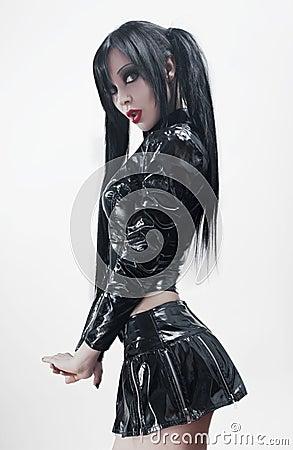 Brunette sexy woman in black vinyl costume