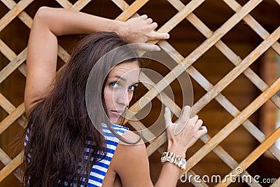 Brunette in striped shirt