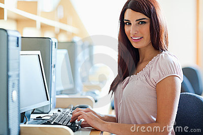 Brunette student posing with a computer