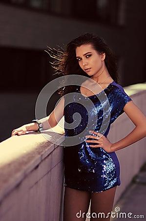 Brunette, stunning woman in mini dress