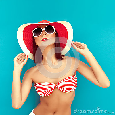 brunette with summer hat in rad bikini