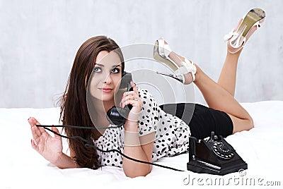 Brunette talking on the retro phone