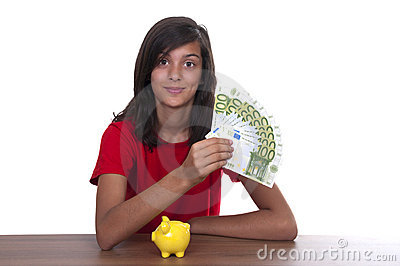 Brunette teen girl with piggy bank