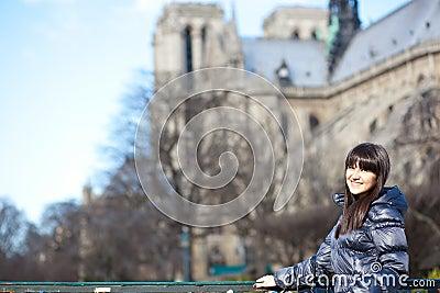 Brunette tourist in Paris near Notre-Dame de Par