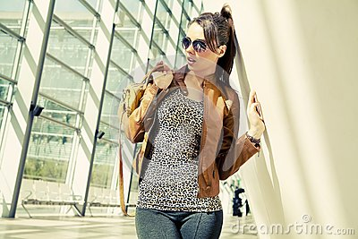 Brunette wearing fashionable clothes