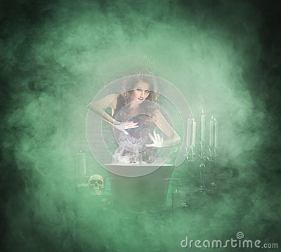 Free Brunette Witch Making Poison In The Dungeon Stock Photo - 33952750