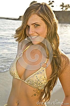 Brunette Woman in Bikini on Beach close up