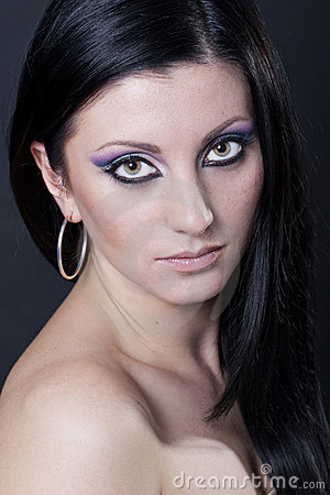 blue and purple makeup. Royalty Free Stock Photography: Brunette woman with lue and purple makeup