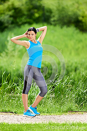 Free Brunette Woman Doing Stretching Exercises Royalty Free Stock Photography - 97048937