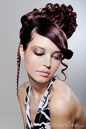 Brunette woman with fashion creative hairstyle