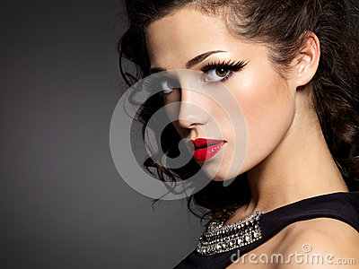 Brunette woman with fashion makeup and red lips