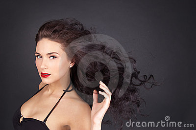 Brunette woman with her hair in movement