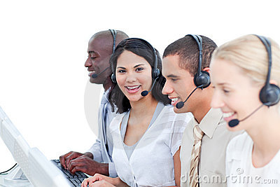 Brunette woman and her team in a call center