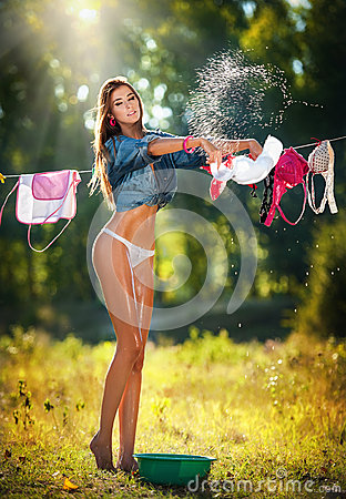 Free Brunette Woman In Bikini And Shirt Putting Clothes To Dry In Sun Stock Photo - 43333170