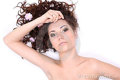 Brunette woman lying with flowers