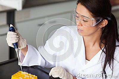 Brunette woman making an experiment