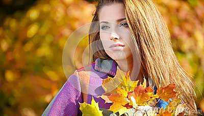 Brunette woman portrait in autumn color