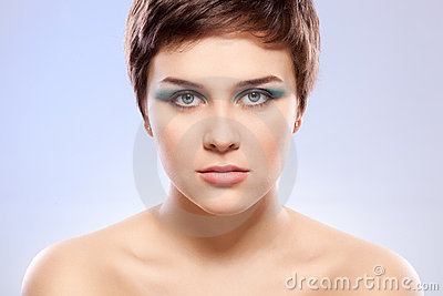 Brunette woman portrait with blue makeup
