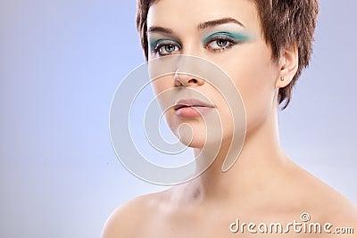 Brunette woman portrait with blue makeup