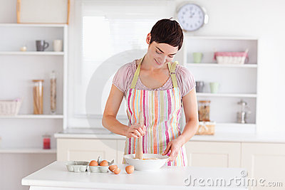 Brunette woman preparing a cake