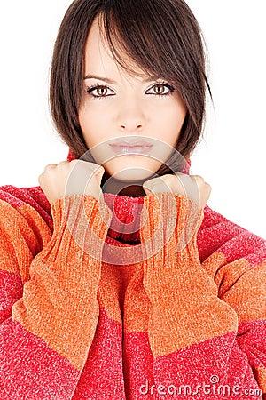 Brunette woman in a red-orange wool sweater