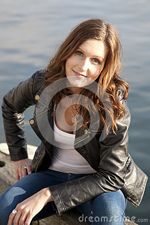 Brunette woman on riverbank