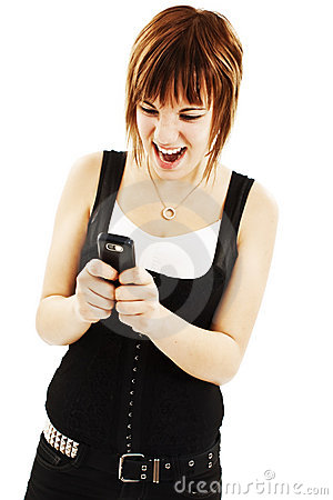 Brunette woman screaming at phone