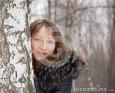 Brunette woman in snow winter park