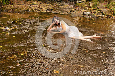 Brunette woman in stream