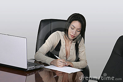 Brunette working at her office desk